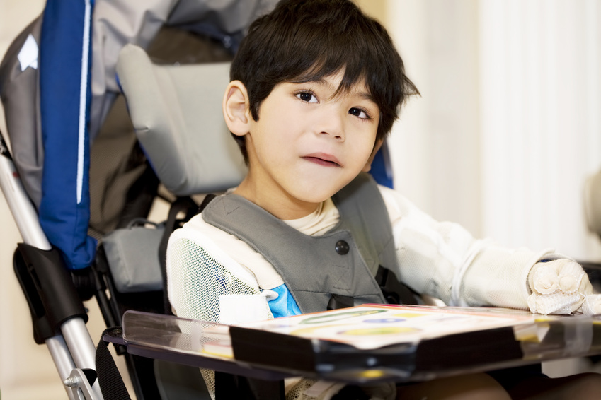 Disabled boy studying